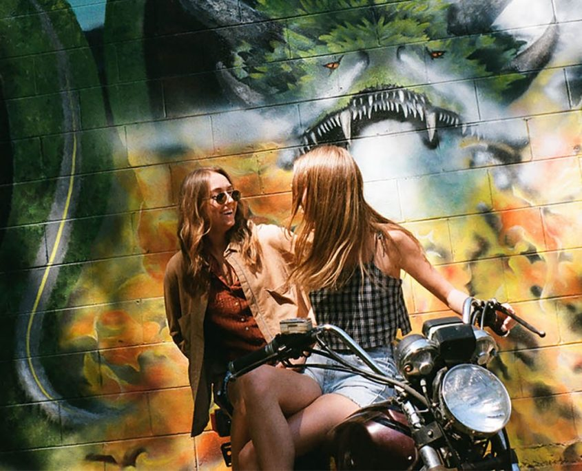 Friends Pose On Motorcycle